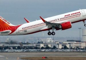 FILE PHOTO: An Air India Airbus A320neo plane takes off in Colomiers near Toulouse